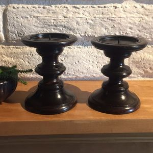 Two brown wood candle holders.